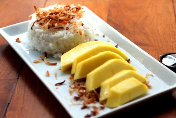 Mango with Sticky Rice on a white tray