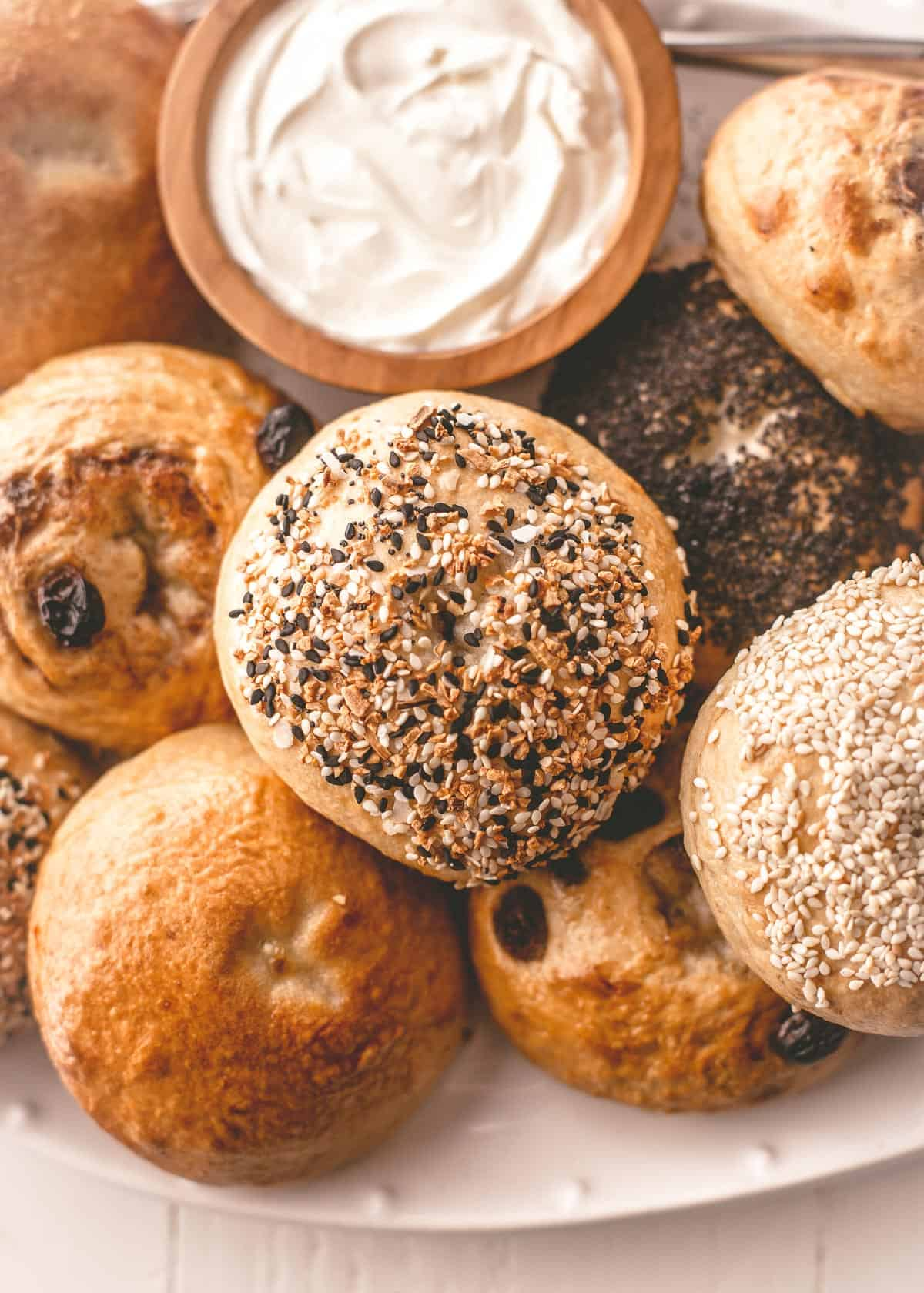 homemade bagels on a wooden board with cream cheese
