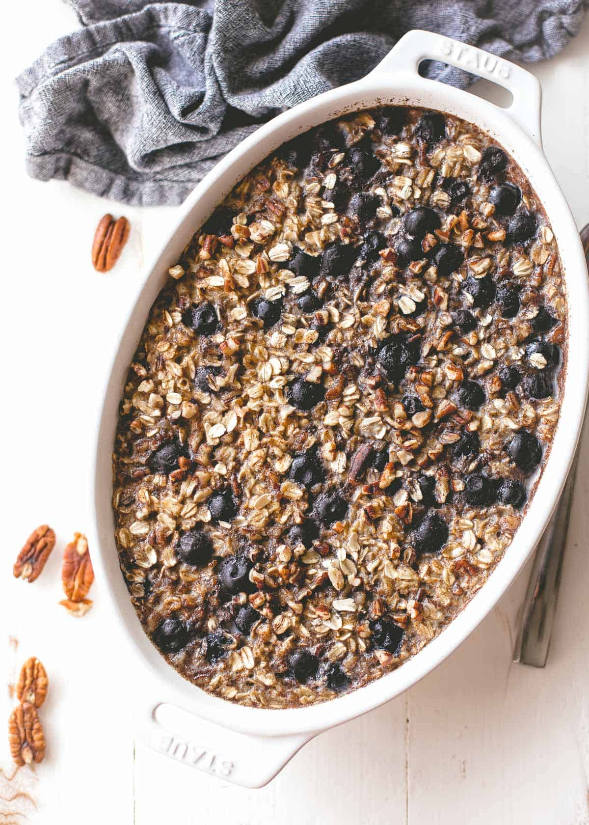 baked blueberry oatmeal in a white baking dish