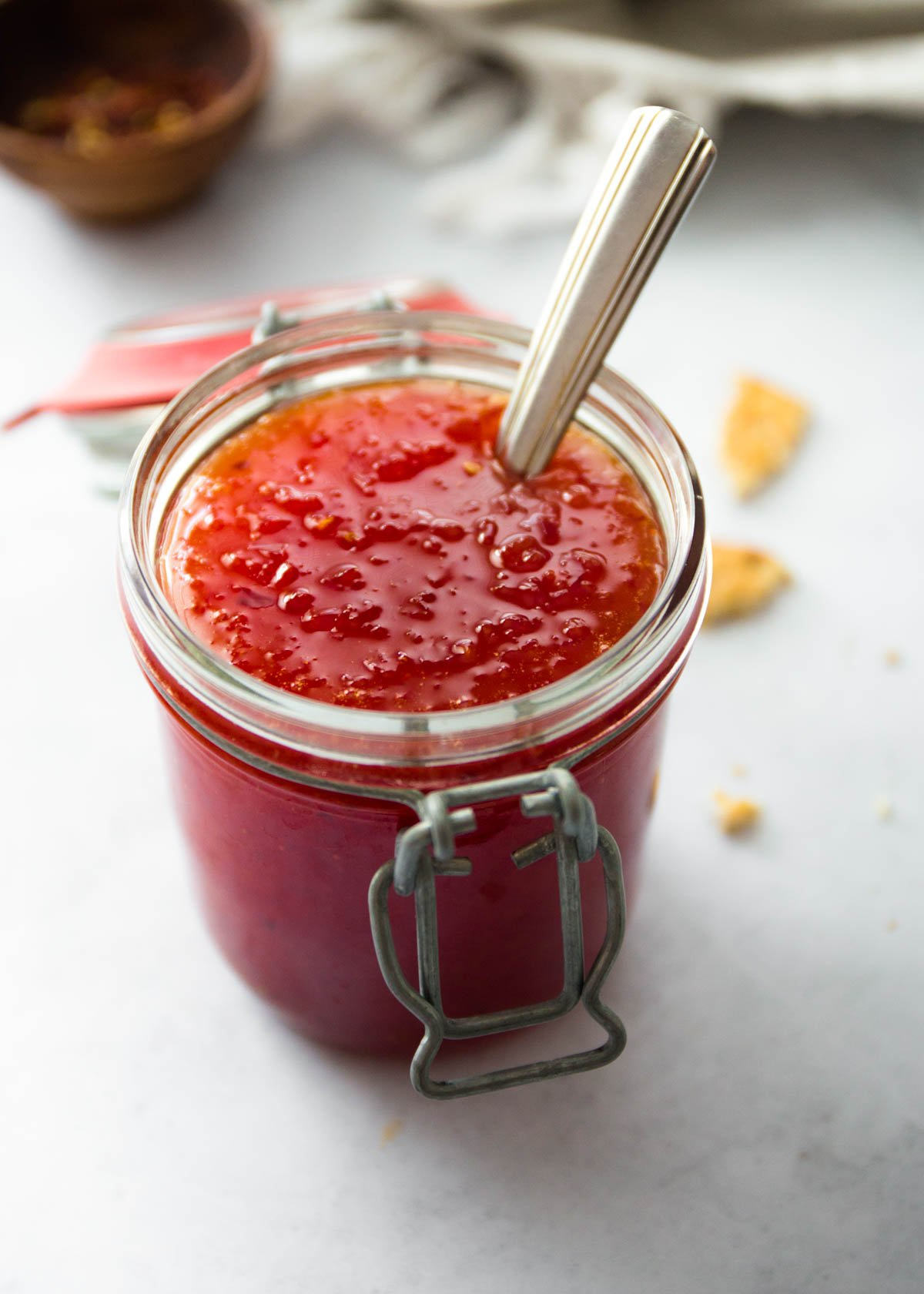 a jar of jelly on a white countertop