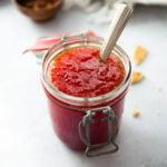 red pepper jelly in a glass jar