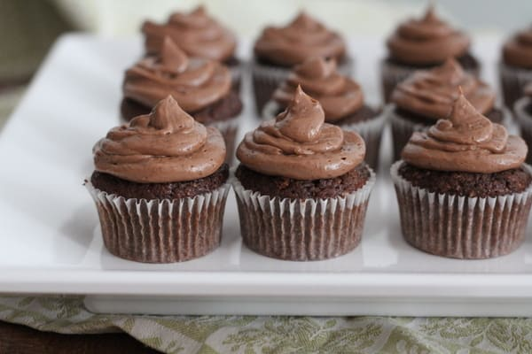 Sour Cream Fudge Cupcakes with Nutella Frosting on a white rectangular tray