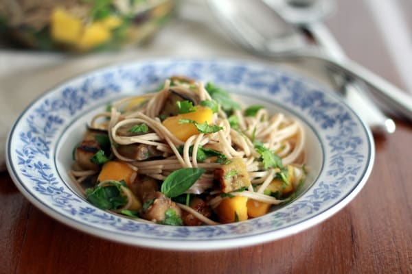 Soba Noodles with Eggplant and Mango in a blue and white bowl