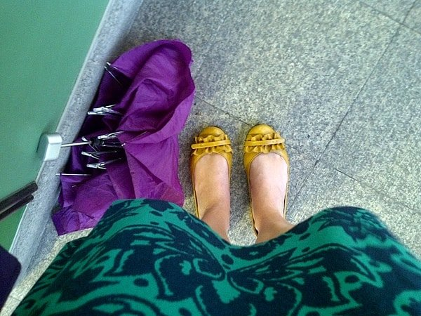 wet shoes and a purple umbrella