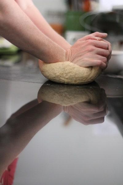 needing bagel dough on a countertop