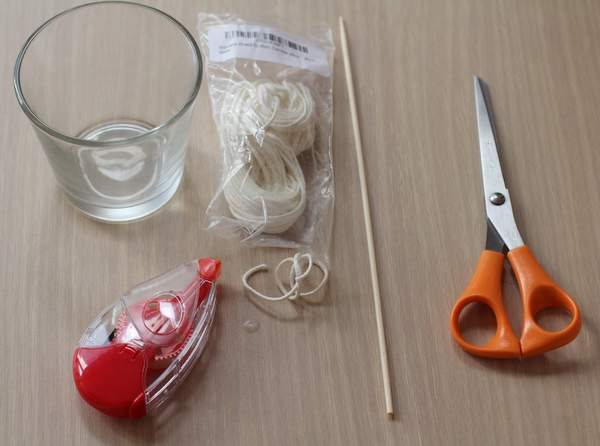 scissors, skewer, wick, and a jar on a table