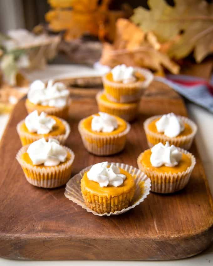Pumpkin Cheesecake Bites on a wooden tray
