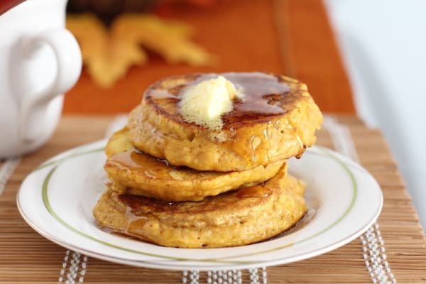 a stack of pancakes on a white plate