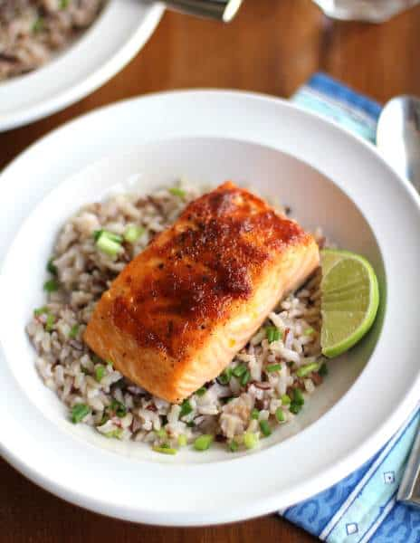 salmon and rice in a white bowl