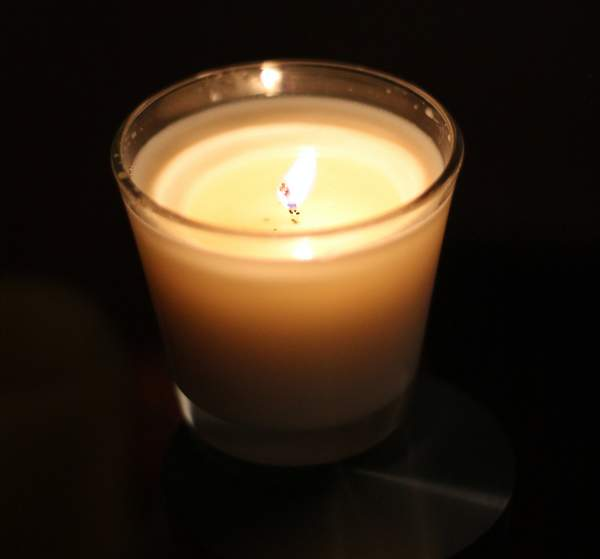 a lit soy candle