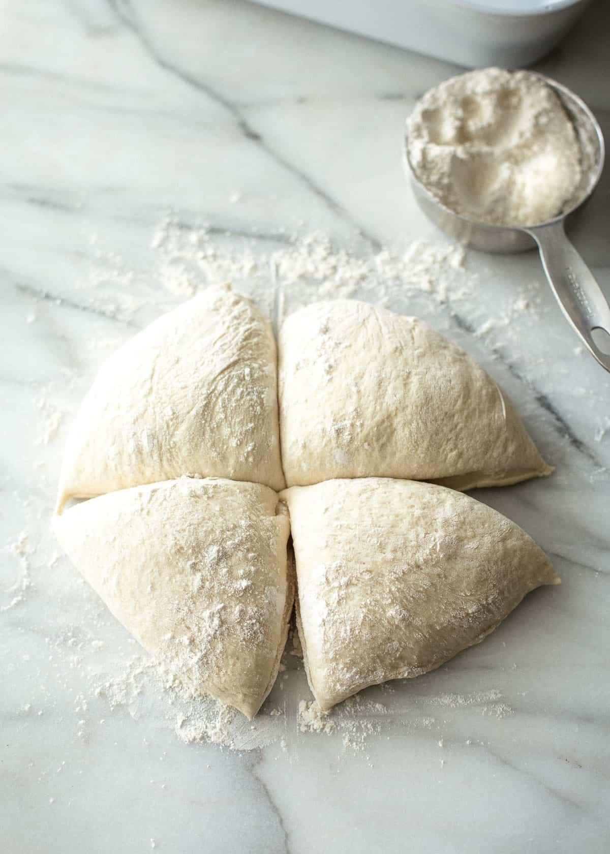 cutting dough into quarters