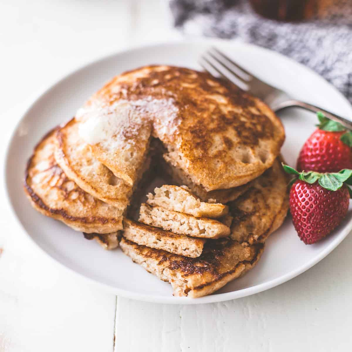 light and fluffy pancakes on a white plate