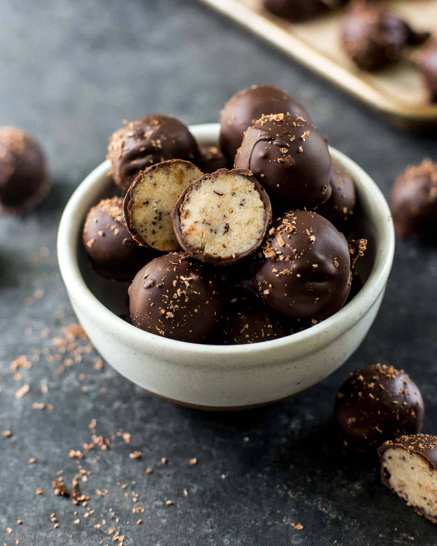 chocolate dipped banana bread truffles in a white bowl