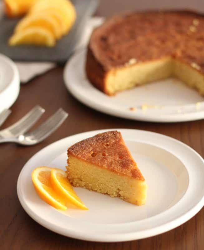 a slice of polenta cake on a white plate