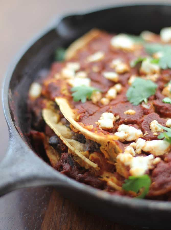 enchiladas in a cast iron skillet