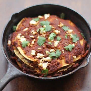 enchiladas in a cast iron pan
