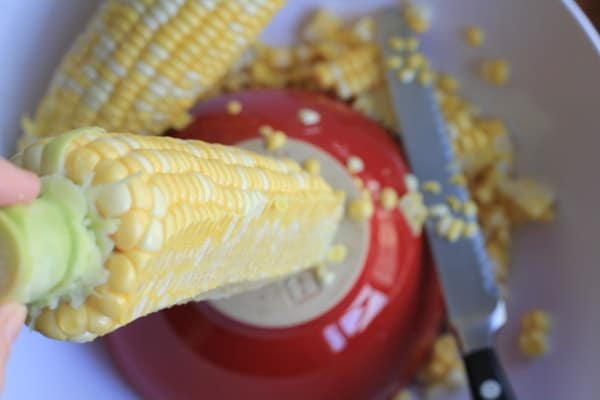 Cutting corn for Mexican Corn Cakes