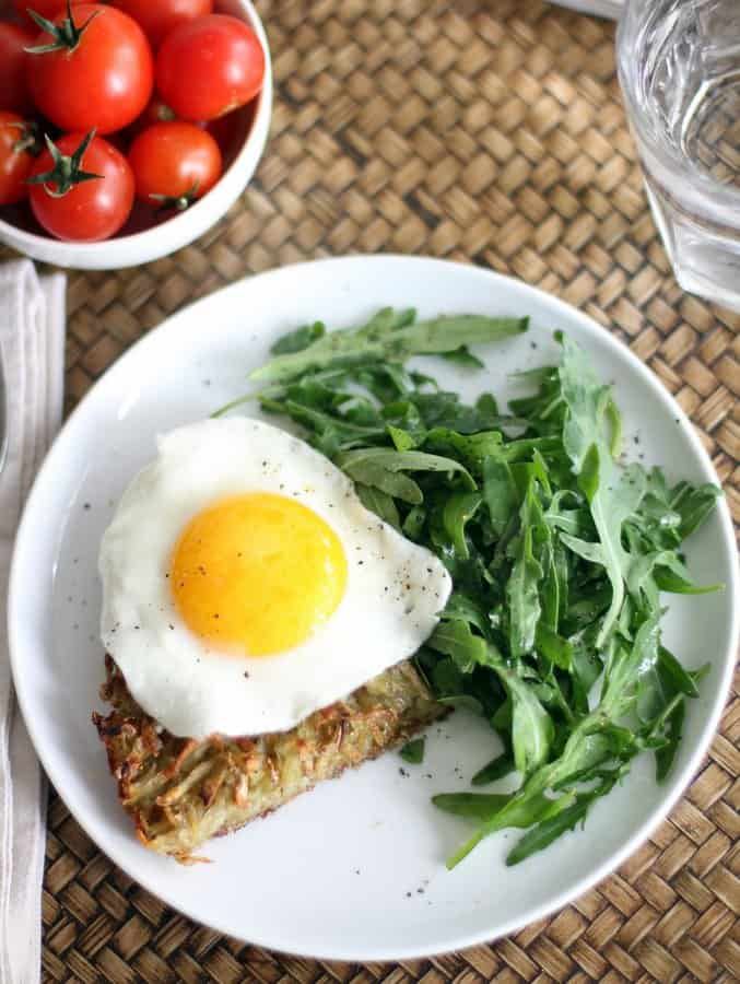 Crispy Skillet Hash Browns on a plate with a fried egg