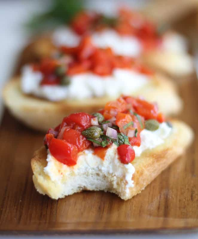 bruschetta with a bite taken out of it