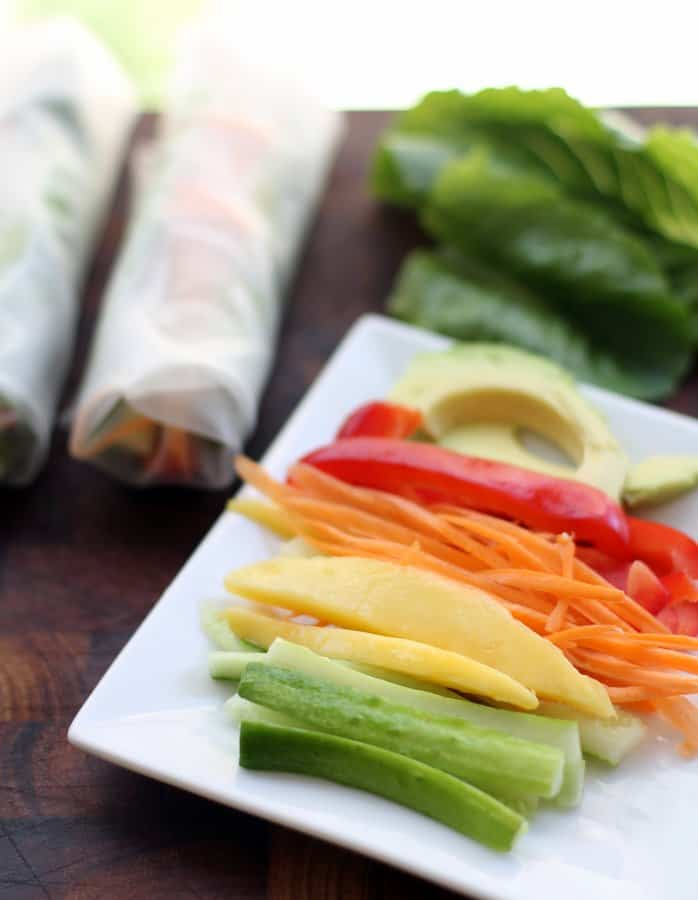 sliced vegetables on a square white plate