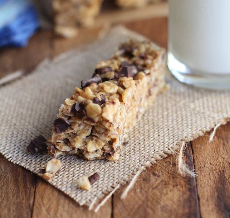 a granola bar with a bite taken out of it on a wooden table
