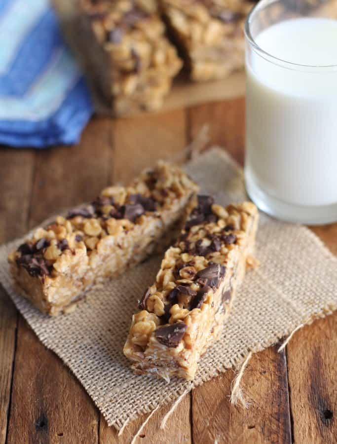homemade bars on a wooden table with a glass of milk