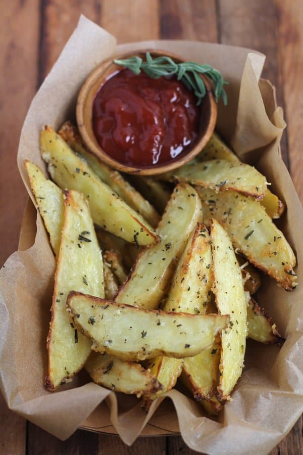fries and ketchup on a wooden table