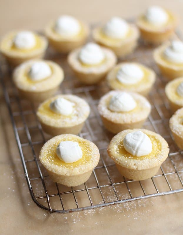lemon tarts on a cooling rack