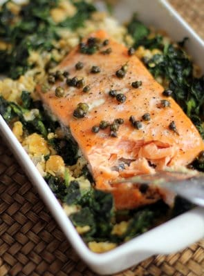 salmon with greens in a baking dish