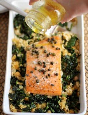 adding vinaigrette to salmon