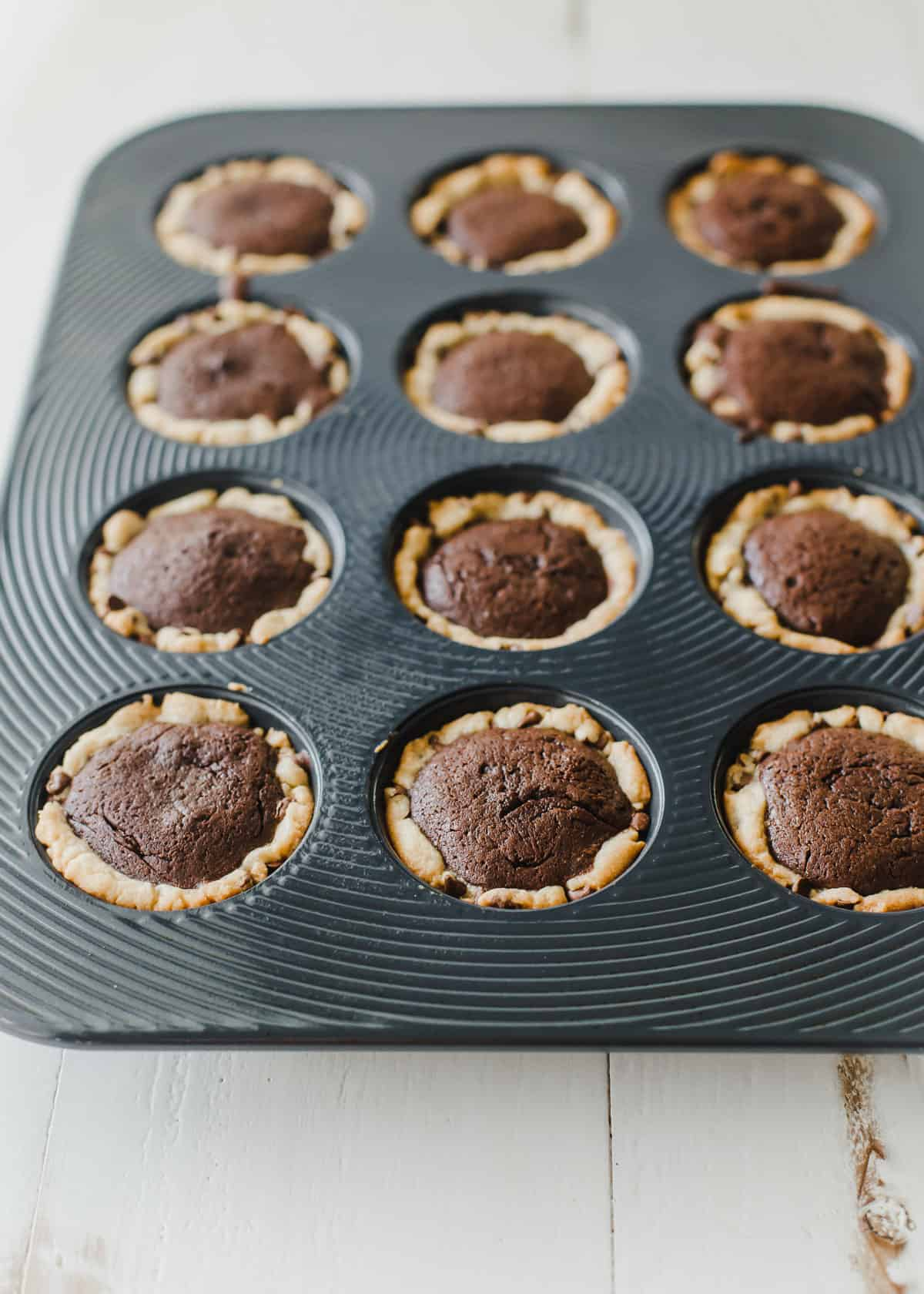 chocolate chip brownie tarts in regular muffin tin