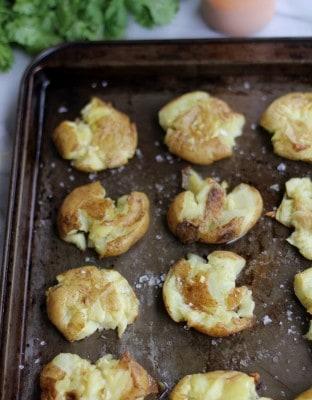smashed potatoes on a sheet pan