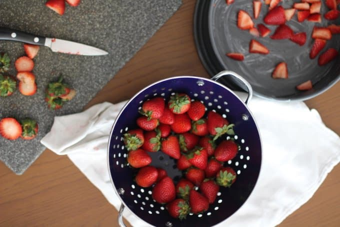 Strawberries in a blue colander