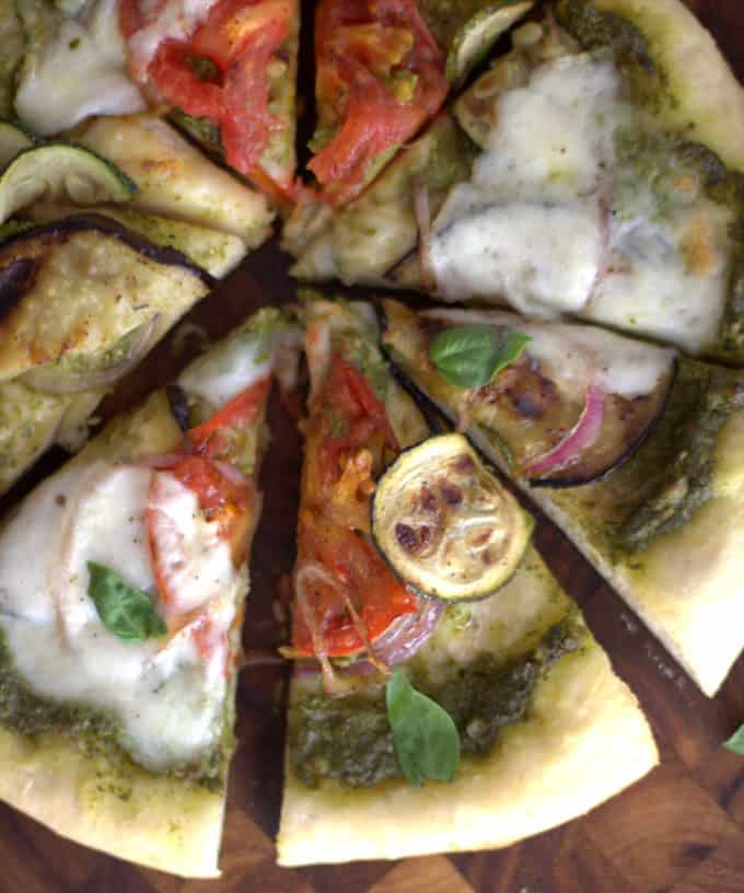summer vegetable pizza cut into slices