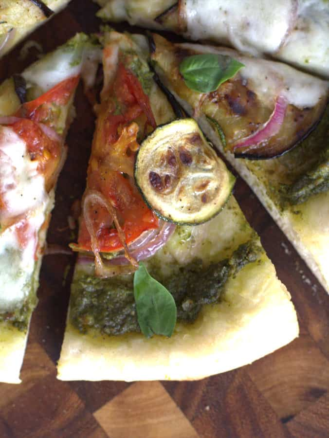 a slice of vegetable pizza