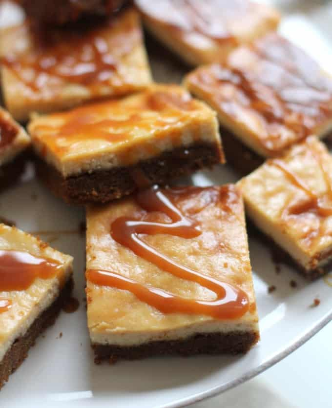 Apple Cider Bars with Caramel Topping stacked on a white plate