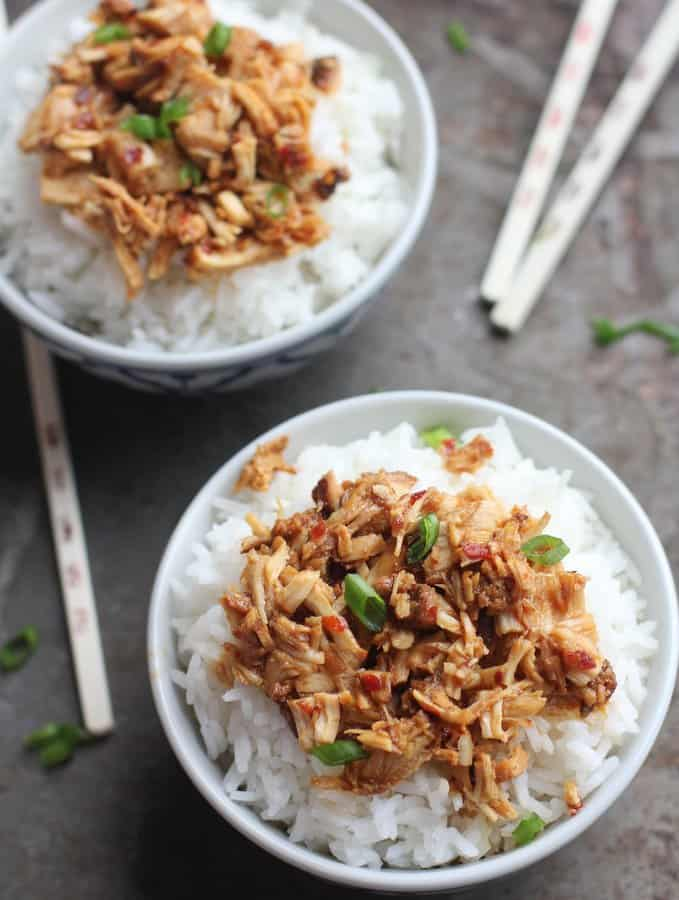 Chicken in bowls over rice