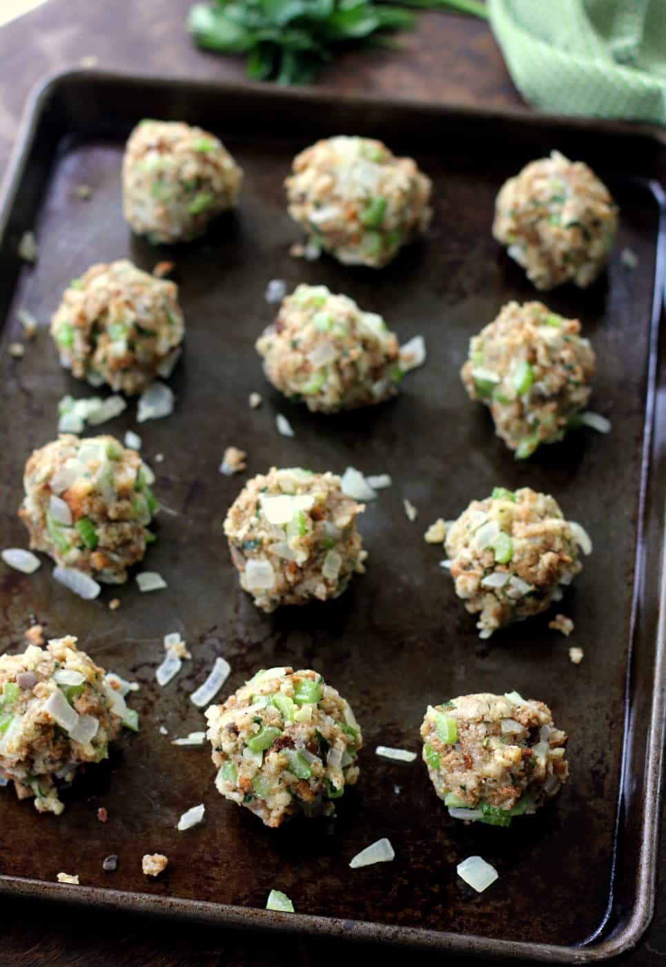 uncooked Stuffing Balls on a sheet pan