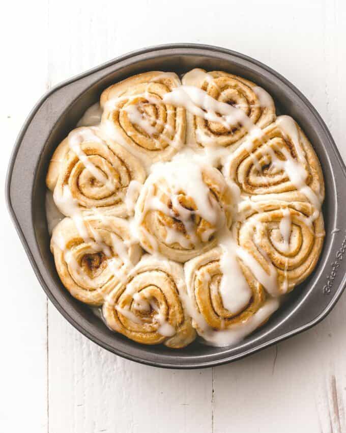cinnamon rolls in a round baking pan