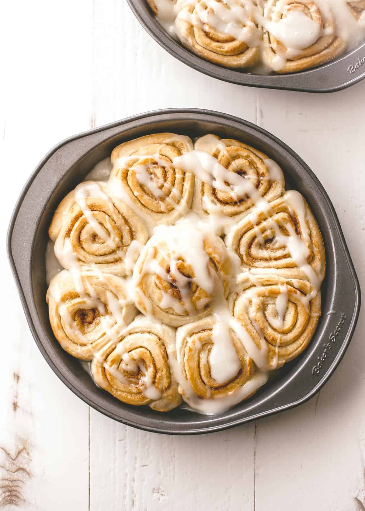 cinnamon rolls in a round baking pan