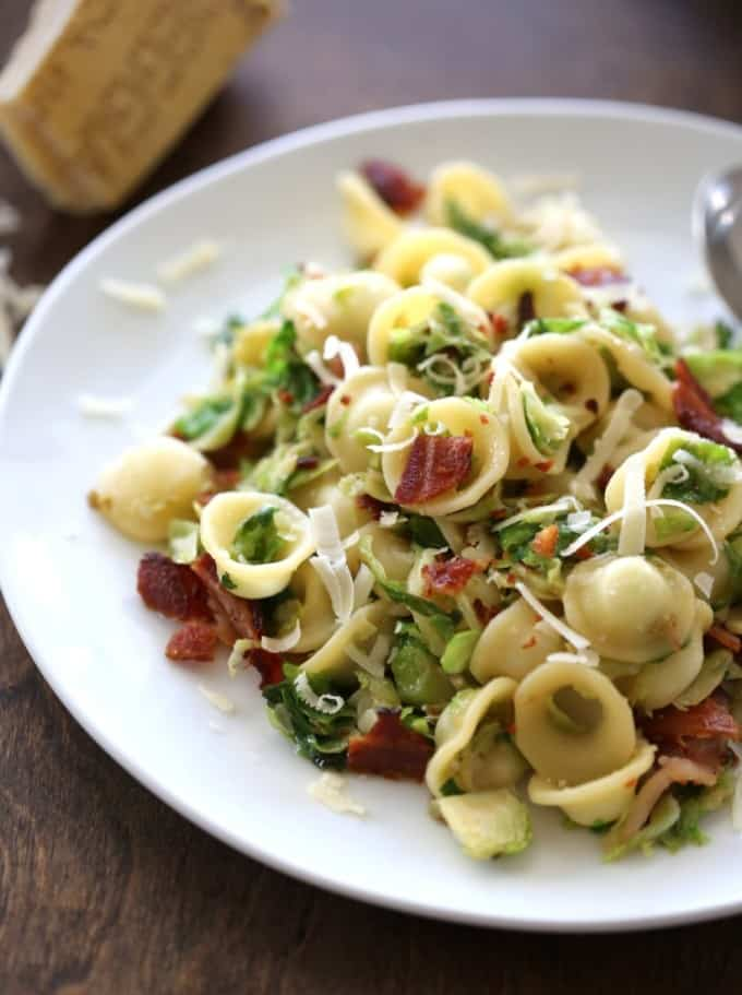 Orecchiette with Bacon and Caramelized Brussels Sprouts on a white plate