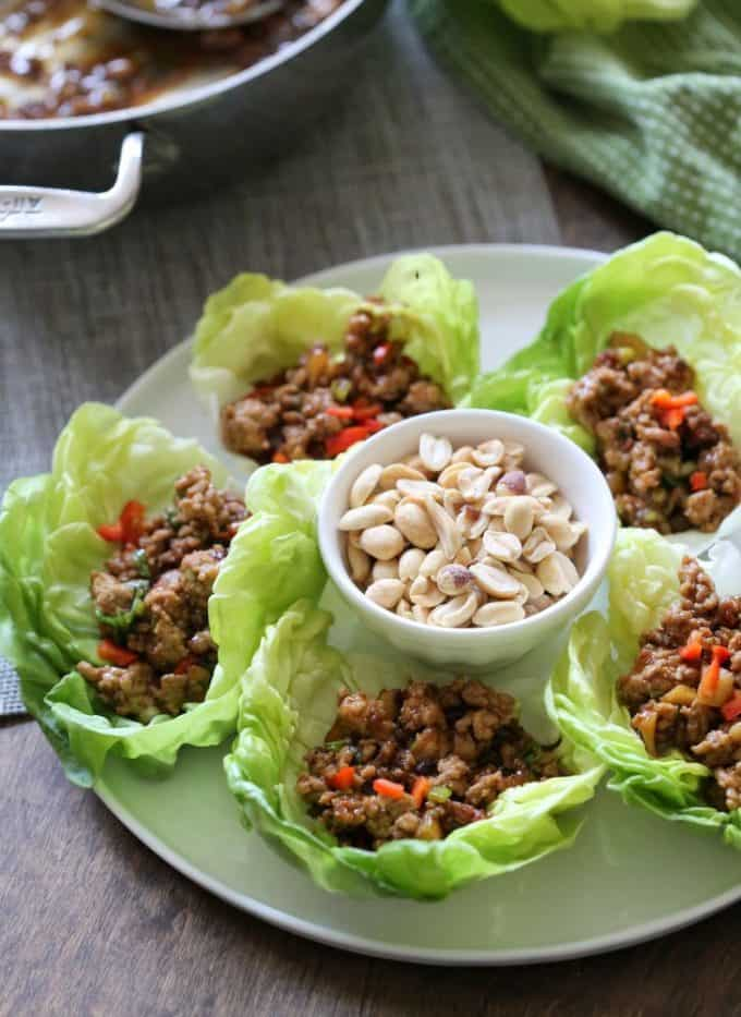 chicken lettuce cups on a white plate