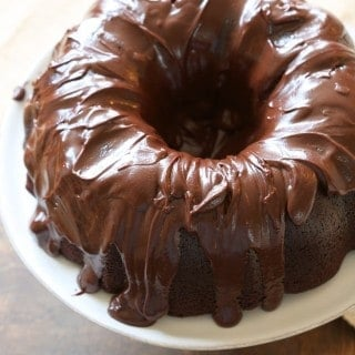 chocolate bundt cake on a white plate