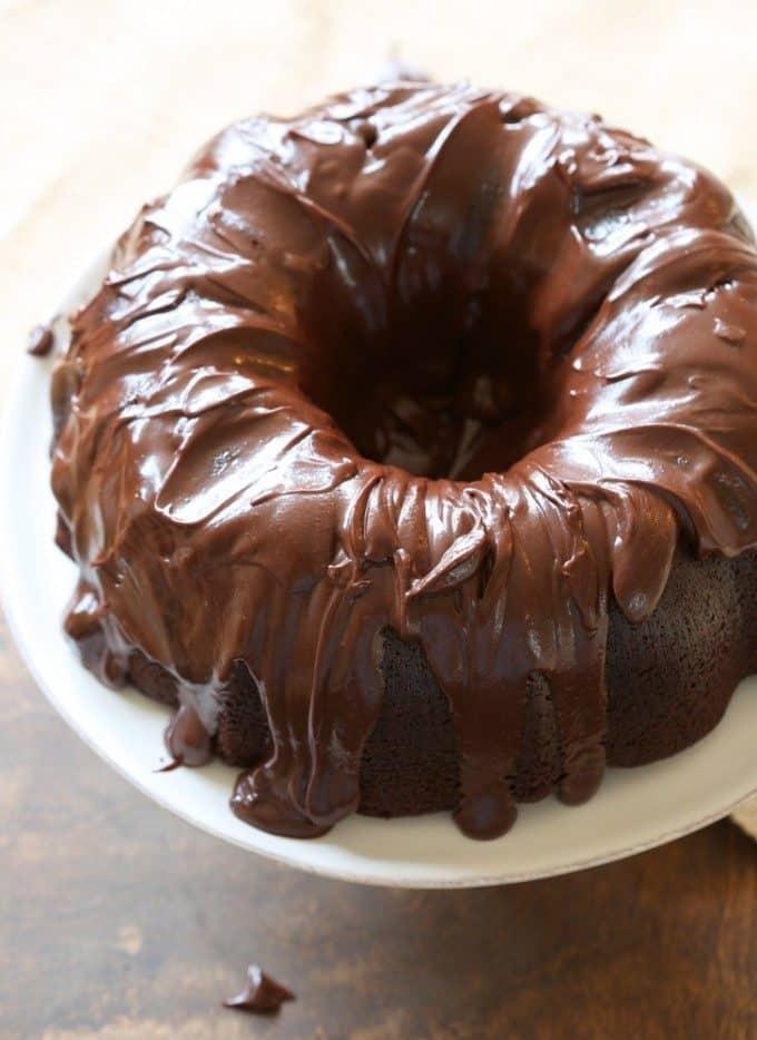 bundt cake on a white cake plate