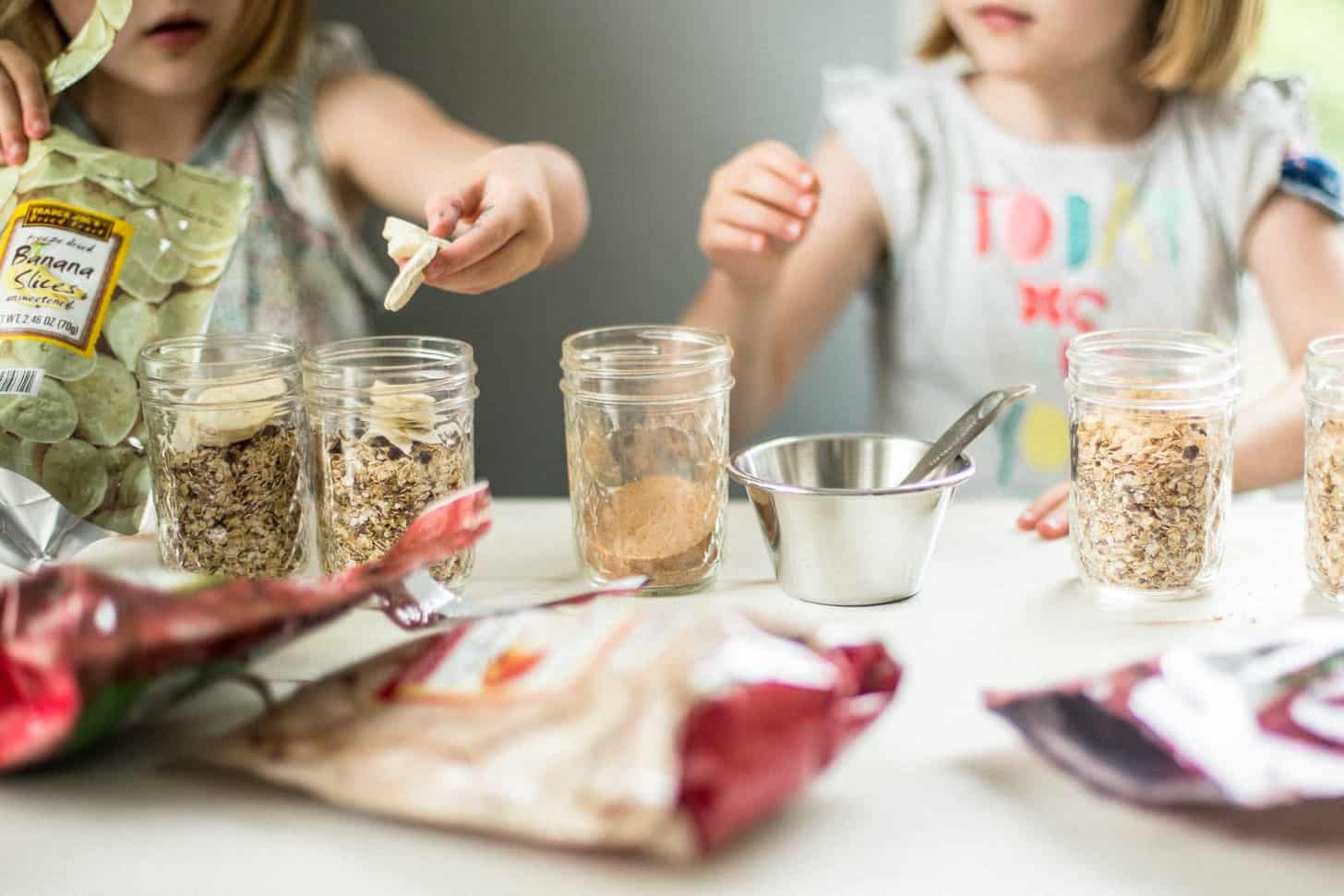 adding toppings to oatmeal