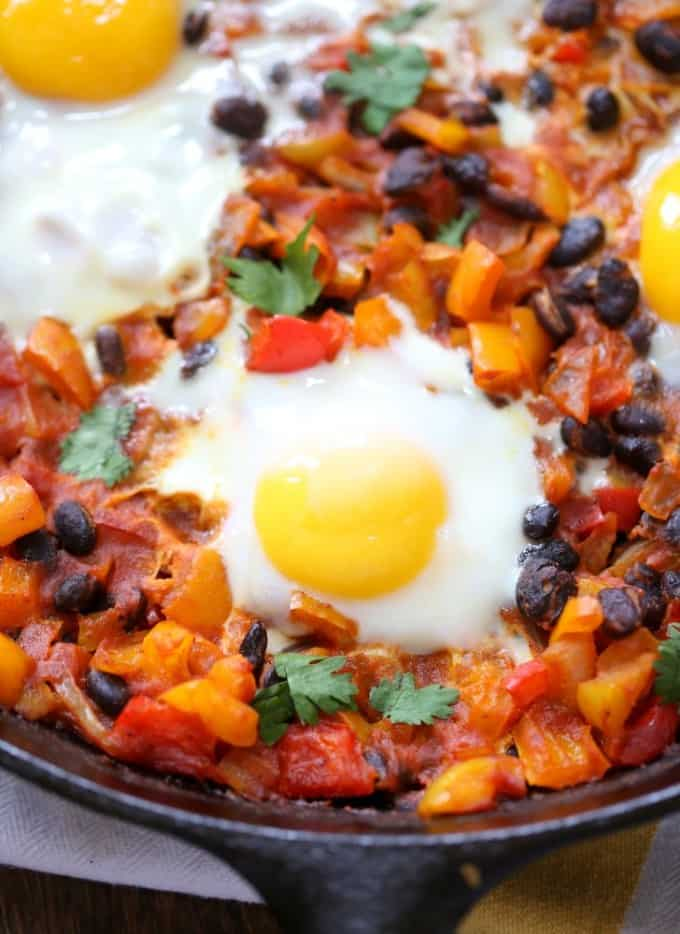 a fried egg on top of cooked vegetables