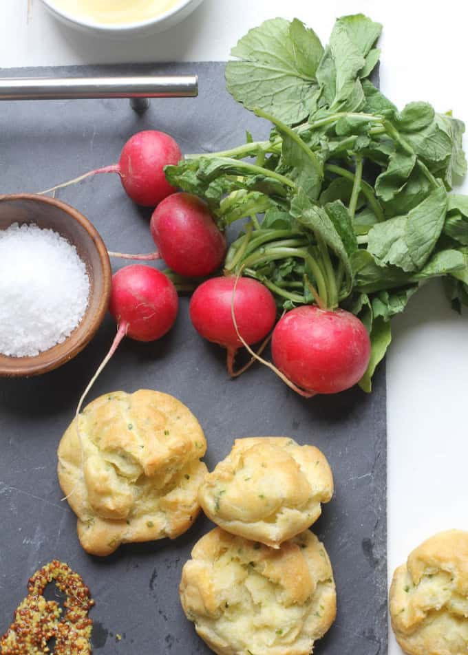 gougeres and radishes on a cheese board