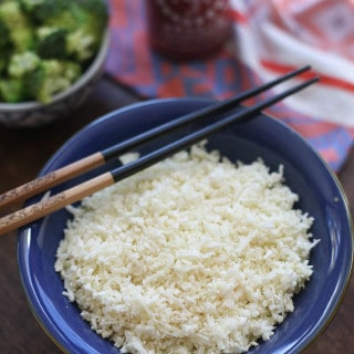 Light and Fluffy Cauliflower Rice in a blue bowl