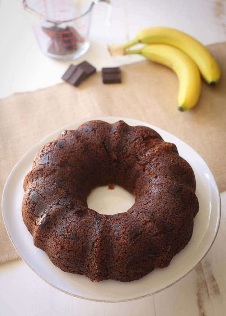 Bundt Cake with Chocolate on a white cake plate