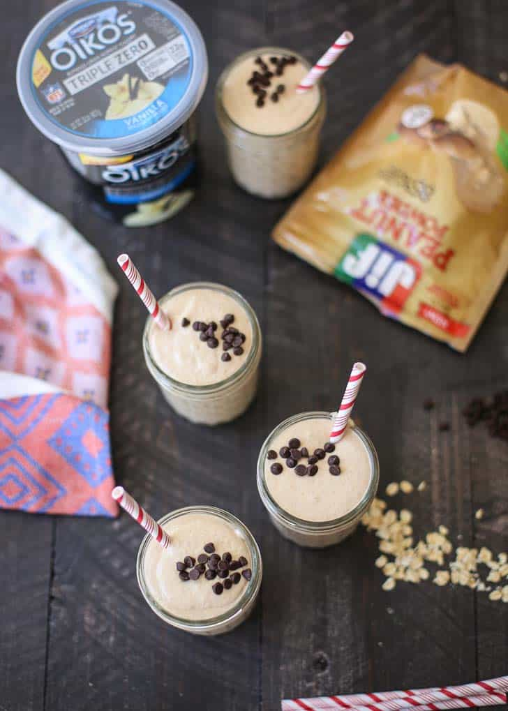 Smoothies in mason jars on a wooden table